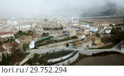 Купить «View from drone of roofs of houses in traditional village of Liedena in foggy morning, Navarre, Spain», видеоролик № 29752294, снято 23 декабря 2018 г. (c) Яков Филимонов / Фотобанк Лори