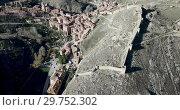 Купить «View from drone of Albarracin cityscape with ancient defensive walls and Cathedral tower, Aragon, Spain», видеоролик № 29752302, снято 26 декабря 2018 г. (c) Яков Филимонов / Фотобанк Лори