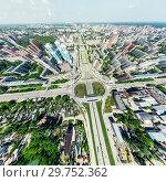 Купить «Aerial city view with crossroads and roads, houses, buildings, parks and parking lots. Sunny summer panoramic image», фото № 29752362, снято 23 января 2019 г. (c) Александр Маркин / Фотобанк Лори