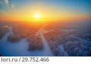 Купить «Sun over siberian forest under the snow at morning time. Siberian rural winter sunrise landscape with birch trees covered with hoarfrost.», фото № 29752466, снято 4 января 2019 г. (c) Serg Zastavkin / Фотобанк Лори