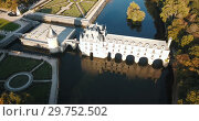 Купить «Aerial view of picturesque autumn landscape with famous medieval Chateau de Chenonceau in Loire Valley, France», видеоролик № 29752502, снято 8 октября 2018 г. (c) Яков Филимонов / Фотобанк Лори