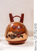 Купить «Ancient Peruvian ceramic vessel with a picture of a demon with a severed head, Nazca culture», фото № 29752610, снято 17 января 2019 г. (c) Евгений Харитонов / Фотобанк Лори