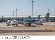 Купить «Planes of the Spanish company Vueling on the airfield of the international airport El Prat, Barcelona, Spain», фото № 29752670, снято 4 апреля 2018 г. (c) Наталья Волкова / Фотобанк Лори