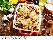 Купить «Chicken thigh baked with rice, eggplant and figs», фото № 29754034, снято 11 марта 2018 г. (c) Надежда Мишкова / Фотобанк Лори