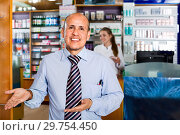 Купить «Smiling friendly pharmaceutists at reception of drugstore», фото № 29754450, снято 26 июня 2019 г. (c) Яков Филимонов / Фотобанк Лори