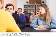 Купить «attentive male and female students following explanations of teacher», фото № 29754486, снято 28 февраля 2017 г. (c) Яков Филимонов / Фотобанк Лори