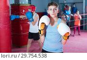Купить «Young serious teenager with boxing gloves posing», фото № 29754538, снято 12 апреля 2017 г. (c) Яков Филимонов / Фотобанк Лори