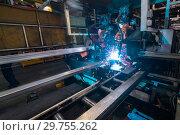 Купить «Welding robot, the process of welding a metal profile.», фото № 29755262, снято 27 сентября 2018 г. (c) Андрей Радченко / Фотобанк Лори