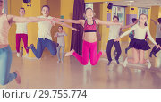 Купить «Children with teacher jumping in dance hall», фото № 29755774, снято 3 марта 2018 г. (c) Яков Филимонов / Фотобанк Лори