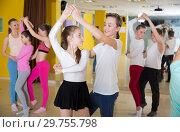 Купить «Tweens practicing jive in dance class», фото № 29755798, снято 3 марта 2018 г. (c) Яков Филимонов / Фотобанк Лори