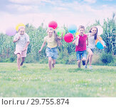 Купить «Four happy kids running on green lawn», фото № 29755874, снято 22 января 2019 г. (c) Яков Филимонов / Фотобанк Лори