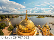Купить «Panorama of the Nilo-Stolobensky desert in the Tver region on the background of lake Seliger with the dome of the Epiphany Cathedral of the monastery. Tver region, Russia», фото № 29767682, снято 16 августа 2014 г. (c) Наталья Волкова / Фотобанк Лори