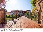 Купить «Bridge paved of bricks over Ill river, Strasbourg», фото № 29767994, снято 28 мая 2017 г. (c) Сергей Новиков / Фотобанк Лори