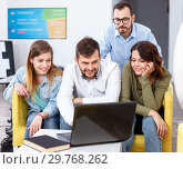 Купить «Young people friendly discussing while sitting with laptop in common hall of hostel», фото № 29768262, снято 24 мая 2018 г. (c) Яков Филимонов / Фотобанк Лори