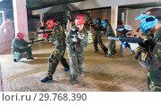 Купить «Players are targeting in opponents from cover in battlefield.», фото № 29768390, снято 10 июля 2017 г. (c) Яков Филимонов / Фотобанк Лори