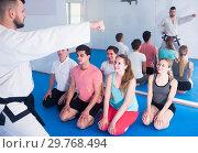 Купить «Karate teacher demonstrates techniques of receptions», фото № 29768494, снято 8 апреля 2017 г. (c) Яков Филимонов / Фотобанк Лори
