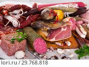Купить «Variety of meats on table», фото № 29768818, снято 5 июля 2020 г. (c) Яков Филимонов / Фотобанк Лори
