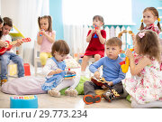 Group of children age 3-4 years playing diverse musical toys. Early musical education in kindergarten. Стоковое фото, фотограф Оксана Кузьмина / Фотобанк Лори