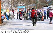Купить «People at the mountain ski resort in winter sunny day», видеоролик № 29773650, снято 23 января 2019 г. (c) FotograFF / Фотобанк Лори