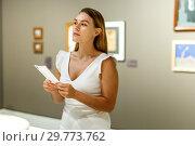 Купить «Woman observing museum exposition», фото № 29773762, снято 28 июля 2018 г. (c) Яков Филимонов / Фотобанк Лори