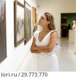 Купить «Woman visiting painting exhibition», фото № 29773770, снято 28 июля 2018 г. (c) Яков Филимонов / Фотобанк Лори