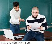 Купить «Male student having difficulties with studies», фото № 29774170, снято 17 декабря 2018 г. (c) Яков Филимонов / Фотобанк Лори