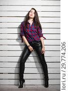Купить «Pretty young brunette posing in the studio.», фото № 29774206, снято 26 апреля 2016 г. (c) Сергей Сухоруков / Фотобанк Лори