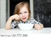 Lovely girl eating soup. Стоковое фото, фотограф ivolodina / Фотобанк Лори
