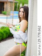Купить «Charming young woman dressed in swimsuit.», фото № 29778662, снято 1 июня 2016 г. (c) Сергей Сухоруков / Фотобанк Лори
