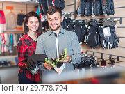 Купить «Couple deciding on protective gloves», фото № 29778794, снято 8 марта 2017 г. (c) Яков Филимонов / Фотобанк Лори