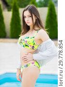 Купить «Nice young brunette in a swimsuit.», фото № 29778854, снято 1 июня 2016 г. (c) Сергей Сухоруков / Фотобанк Лори