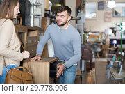 Купить «Guy with girlfriend choosing bedside chest», фото № 29778906, снято 9 ноября 2017 г. (c) Яков Филимонов / Фотобанк Лори