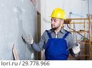 Купить «Professional is checking the quality of the work done after the plaster wall», фото № 29778966, снято 3 июня 2017 г. (c) Яков Филимонов / Фотобанк Лори