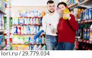 Купить «People buying detergents for house», фото № 29779034, снято 14 марта 2017 г. (c) Яков Филимонов / Фотобанк Лори
