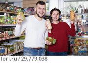 Купить «Customers purchasing tinned food at supermarket», фото № 29779038, снято 14 марта 2017 г. (c) Яков Филимонов / Фотобанк Лори