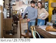 Купить «Couple choosing stylish chairs», фото № 29779070, снято 9 ноября 2017 г. (c) Яков Филимонов / Фотобанк Лори