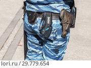 Купить «Russian policewoman with gun belt, handcuffs gun, shoker and holster», фото № 29779654, снято 5 мая 2018 г. (c) FotograFF / Фотобанк Лори
