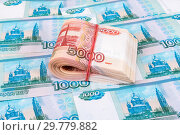 Купить «Folded five thousandths banknotes of russian roubles over banknotes background», фото № 29779882, снято 9 января 2017 г. (c) FotograFF / Фотобанк Лори