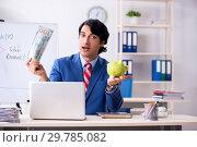 Купить «Busy businessman explaining business charts», фото № 29785082, снято 15 октября 2018 г. (c) Elnur / Фотобанк Лори