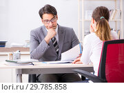 Купить «Man and woman discussing in office», фото № 29785858, снято 31 июля 2018 г. (c) Elnur / Фотобанк Лори