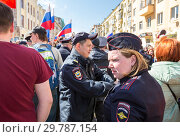 Купить «Russian policeman and policewoman during an opposition protest rally», фото № 29787154, снято 5 мая 2018 г. (c) FotograFF / Фотобанк Лори