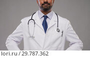 Купить «smiling indian male doctor with stethoscope», видеоролик № 29787362, снято 19 января 2019 г. (c) Syda Productions / Фотобанк Лори