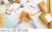 Купить «woman packing parcel box at post office», видеоролик № 29787418, снято 19 января 2019 г. (c) Syda Productions / Фотобанк Лори