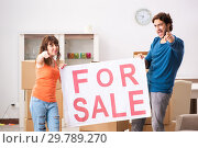 Купить «Young family offering house for sale and moving out», фото № 29789270, снято 21 сентября 2018 г. (c) Elnur / Фотобанк Лори