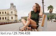 Купить «Young sexy girl tourist in dress playfully posing port of Barcelona, Spain», видеоролик № 29794438, снято 27 октября 2018 г. (c) Яков Филимонов / Фотобанк Лори