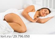 Купить «Woman sleeping in bed», фото № 29796050, снято 23 февраля 2019 г. (c) Яков Филимонов / Фотобанк Лори
