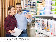 Купить «Two designer with shop list looking paint», фото № 29796226, снято 16 февраля 2018 г. (c) Яков Филимонов / Фотобанк Лори