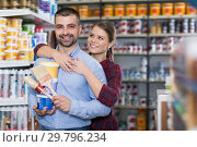 Купить «Glad woman and man with paint and brushes», фото № 29796234, снято 16 февраля 2018 г. (c) Яков Филимонов / Фотобанк Лори