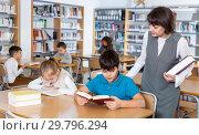 Купить «School kids studying with female teacher», фото № 29796294, снято 19 декабря 2018 г. (c) Яков Филимонов / Фотобанк Лори
