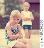 Купить «Small sisters upset after quarrel outside», фото № 29796350, снято 20 июля 2017 г. (c) Яков Филимонов / Фотобанк Лори